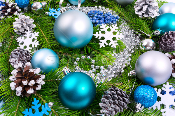 Christmas background with fir branches, silver beads, turquoise  Stock photo © TasiPas