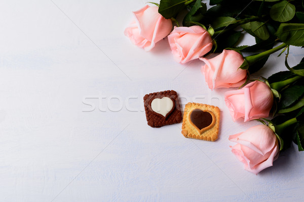 St. Valentine's Day background with five pink roses and cookies Stock photo © TasiPas