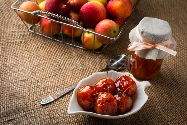 Cherry apples in syrup Stock photo © TasiPas