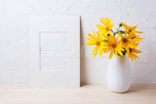 Stock photo: White mat frame mockup with yellow rosinweed flowers in pitcher