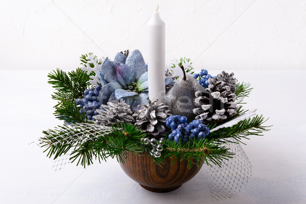 Christmas decoration with candle and blue silk poinsettias Stock photo © TasiPas
