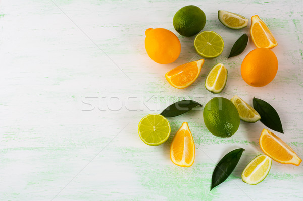 Citrus fruits mix on light green background  Stock photo © TasiPas