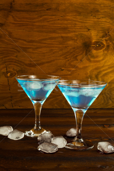 Blue Curacao liqueur cocktail in a martini glasses Stock photo © TasiPas