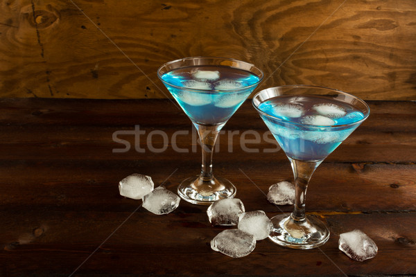 Blue Curacao liqueur served in Martini glass Stock photo © TasiPas