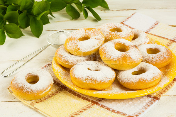 Donuts powdered by caster sugar  Stock photo © TasiPas