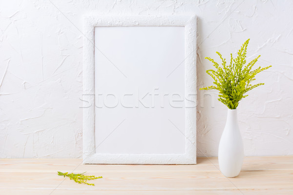 White frame mockup with ornamental grass in exquisite vase Stock photo © TasiPas