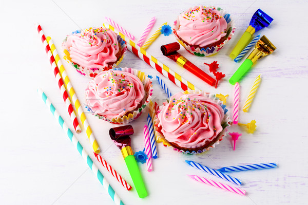 Birthday party concept with decorated pink cupcakes  and candles Stock photo © TasiPas
