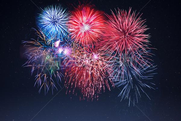 Amazing celebration sparkling fireworks over starry sky Stock photo © TasiPas
