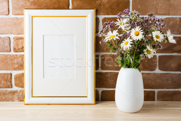 Gold decorated frame mockup with wildflowers bouquet exposed bri Stock photo © TasiPas
