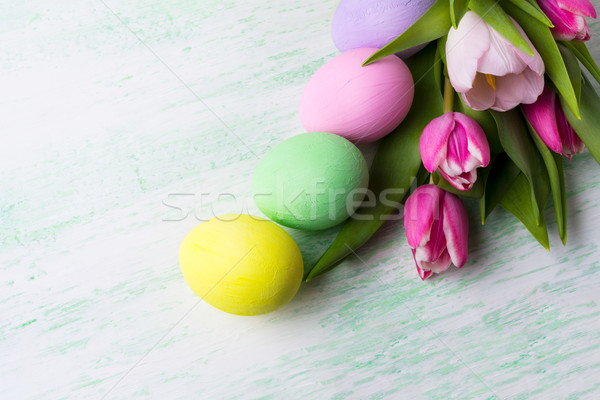 Easter background with purple, pink, green, yellow painted eggs Stock photo © TasiPas