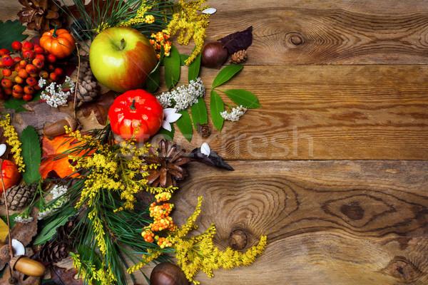 Happy Thanksgiving decor with rowan berries on wooden background Stock photo © TasiPas