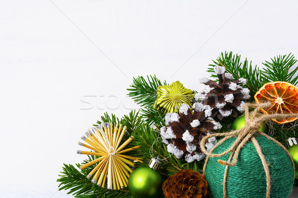 Christmas background with green handmade twine ornament, copy sp Stock photo © TasiPas
