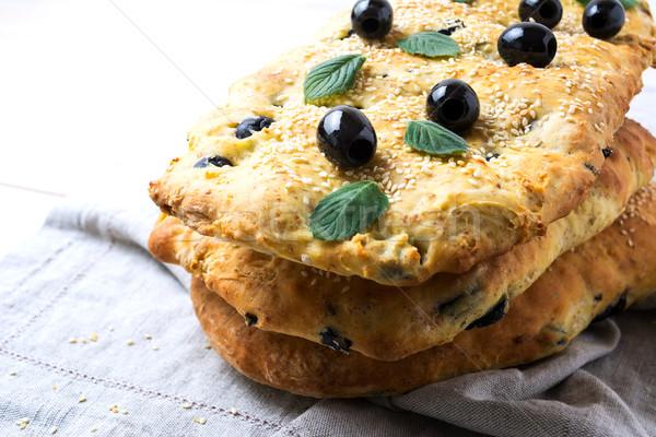 Stack of traditional Italian bread focaccia on the linen napkin Stock photo © TasiPas