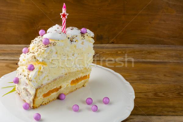 Slice of peach and meringue birthday cake Stock photo © TasiPas