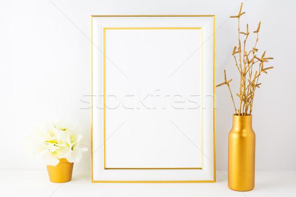 Frame mockup with ivory hydrangea in the golden flower pot  Stock photo © TasiPas