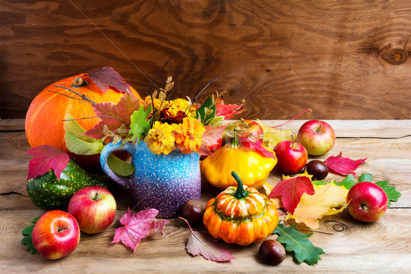 Colorful rustic Thanksgiving decoration with apples and pumpkins Stock photo © TasiPas