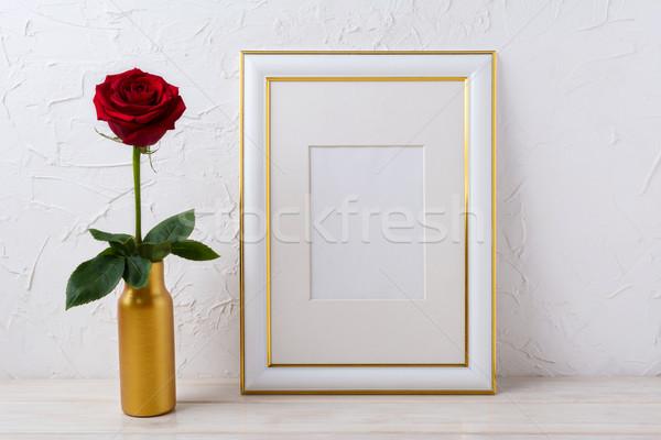 Frame mockup with burgundy red rose in golden vase Stock photo © TasiPas