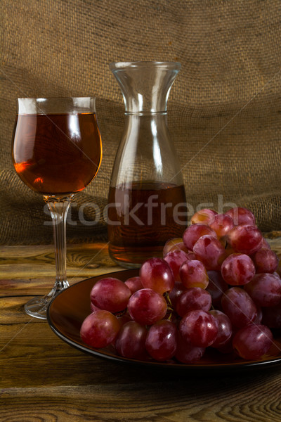 Stock photo: red grapes on dark wooden background