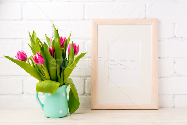 Wooden frame mockup with pink tulips in jug Stock photo © TasiPas