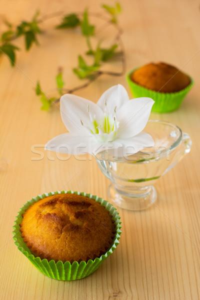 Muffins bloem bladeren groene papier Stockfoto © TasiPas