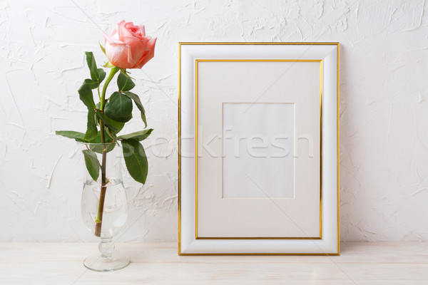 Gold decorated frame mockup with rose in exquisite glass vase Stock photo © TasiPas