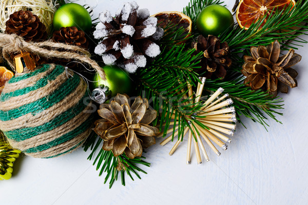 Christmas decoration with rustic homemade ornaments and fir bran Stock photo © TasiPas