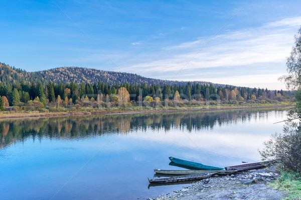 Beautiful autumn day on the tranquil river Stock photo © TasiPas