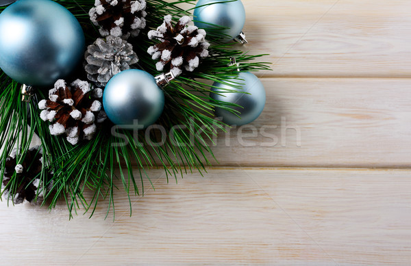 Christmas background with blue ornaments and snowy pinecone Stock photo © TasiPas
