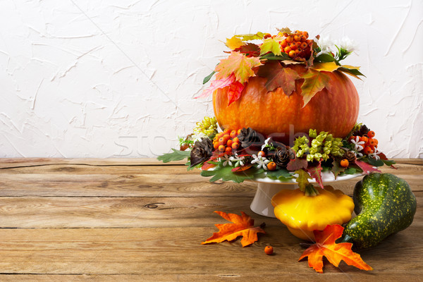 Thanksgiving table centerpiece with pumpkin and yellow squash, c Stock photo © TasiPas