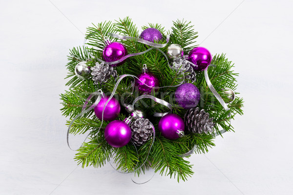 Christmas door wreath with silver pine cones and purple baubles. Stock photo © TasiPas