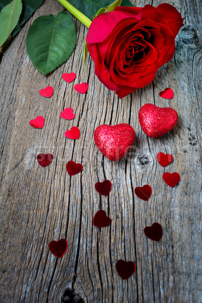 Valentines Day or wedding symbols one red rose and hearts Stock photo © TasiPas