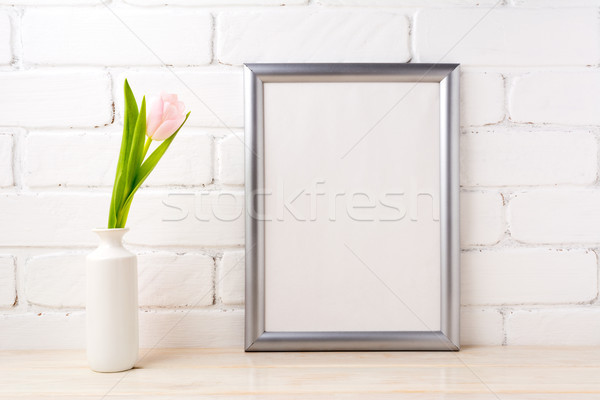 Silver frame mockup with tender soft pink tulip  Stock photo © TasiPas