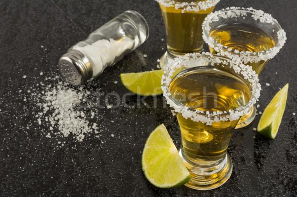 金 テキーラ 石灰 黒 メキシコ料理 ショット ストックフォト © TasiPas