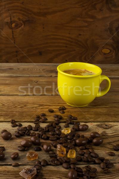 Jaune mug fort café cassonade tasse de café Photo stock © TasiPas