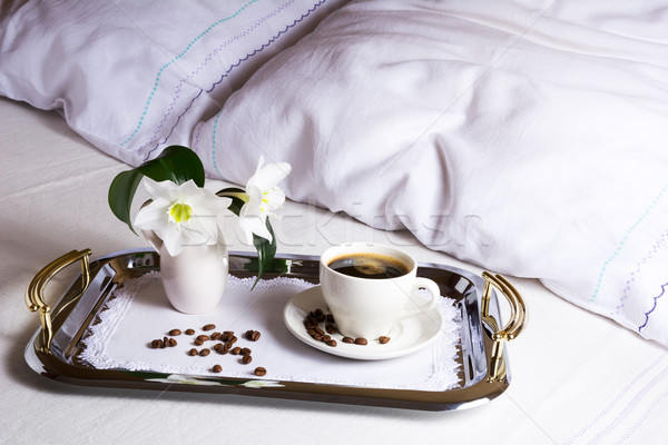 Morning coffee in bed on elegant silver serving tray Stock photo © TasiPas