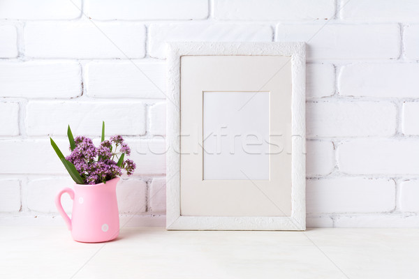 White frame mockup with purple flowers in pink rustic pitcher  Stock photo © TasiPas