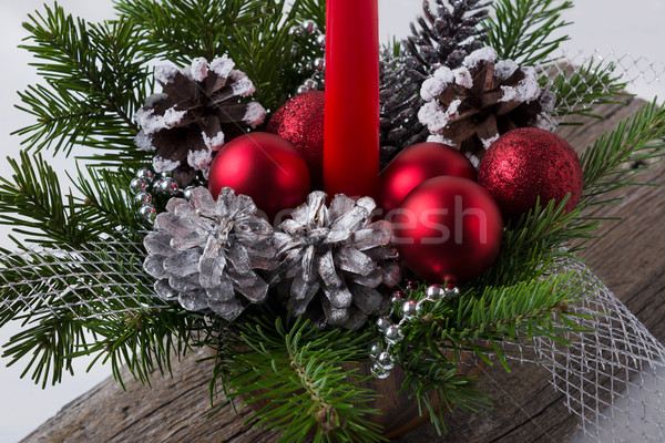 Christmas decoration with red ornaments and silver pine cones Stock photo © TasiPas