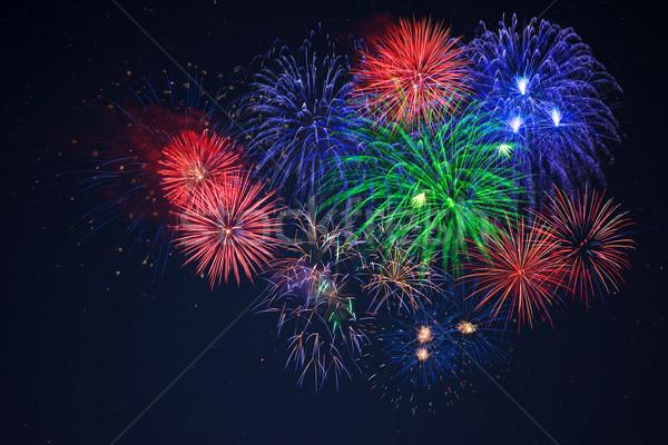 Blue green red fireworks over starry sky Stock photo © TasiPas