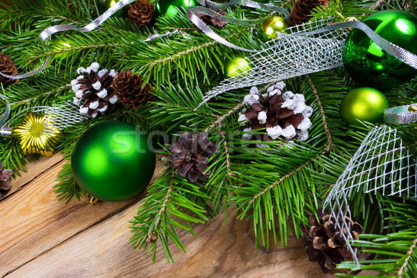 Christmas holiday greeting background with green ornaments Stock photo © TasiPas