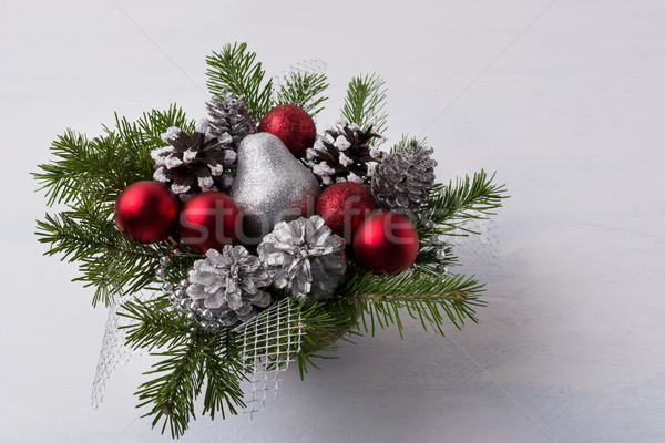 Christmas decoration with red glitter ornaments and silver mash Stock photo © TasiPas