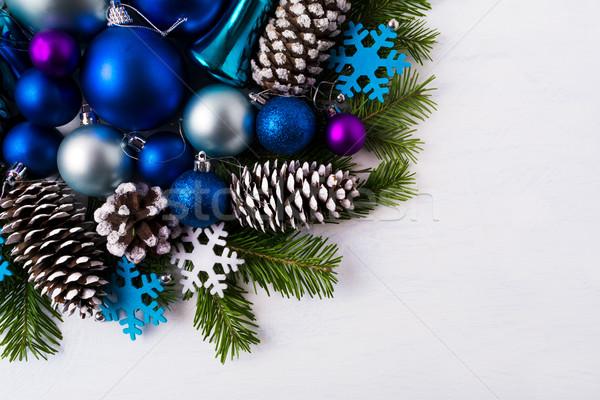 Christmas greeting background with blue and white felt snowflake Stock photo © TasiPas