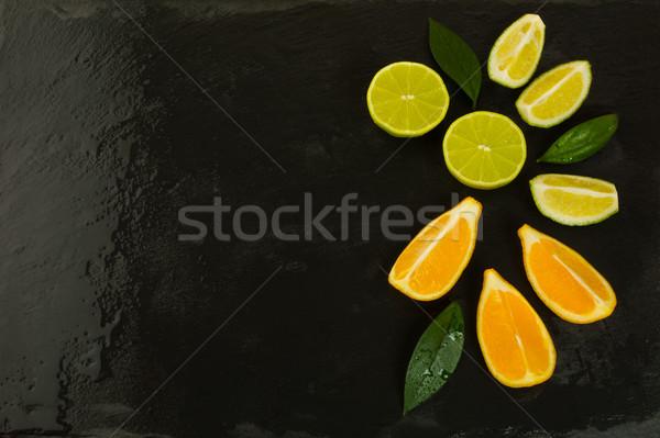 Cal limão fatias preto alimentação saudável maduro Foto stock © TasiPas