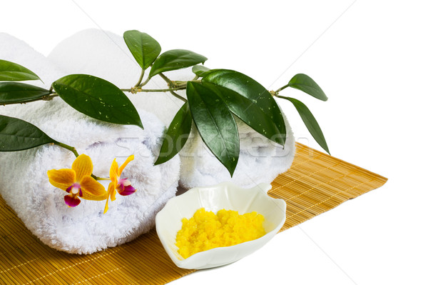 Spa concept with yellow cosmetic salt isolated on white Stock photo © TasiPas
