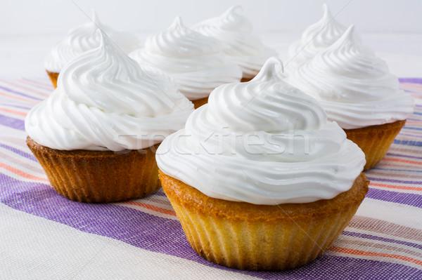 White cupcakes on the linen napkin Stock photo © TasiPas