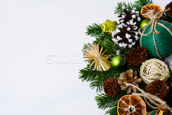 Christmas background with rustic homemade ornaments and fir bran Stock photo © TasiPas
