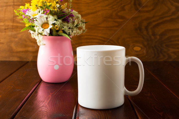 Blanco taza de café flores silvestres vacío taza Foto stock © TasiPas