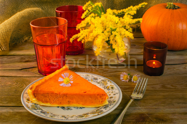 Pumpkin pie and candleholder Stock photo © TasiPas