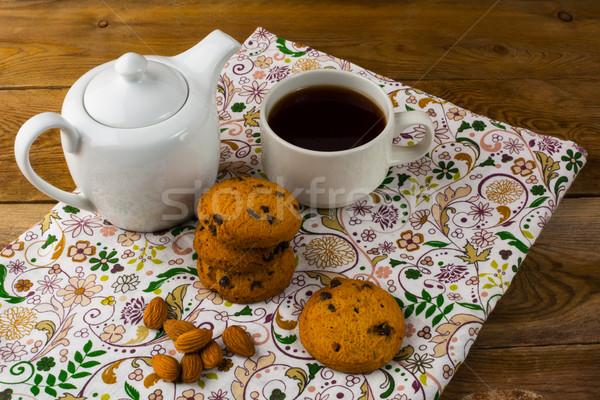 Cookies, almond and tea Stock photo © TasiPas
