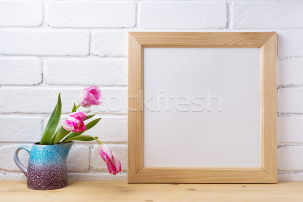 Wooden square frame mockup with pink tulip in purple blue vase Stock photo © TasiPas