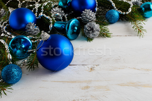 Christmas background with blue ornaments, silver beads and pine  Stock photo © TasiPas